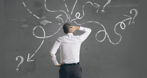 Man at blackboard pondering what can I do - bankruptcy